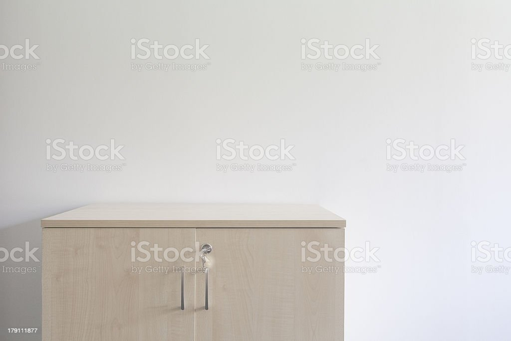 Cabinet against white wall royalty-free stock photo