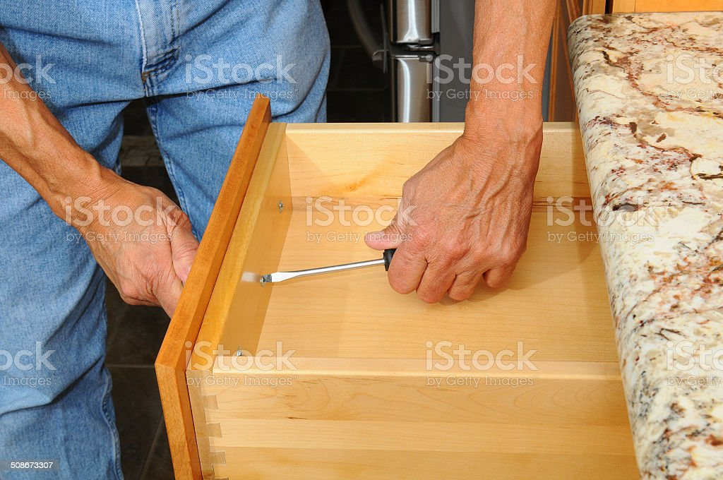 Cabinet Insataller Working on Drawer stock photo