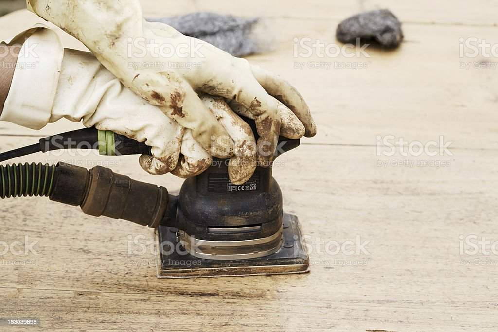 Cabinet maker polishing a table _ Horizontal royalty-free stock photo