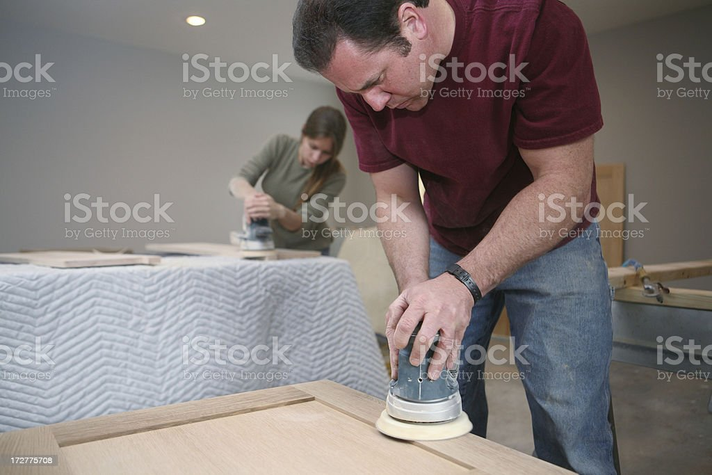 Cabinet Makers Sanding Custom Cabinets royalty-free stock photo
