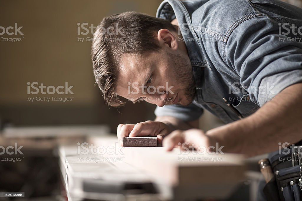 Cabinetmaker during work in workshop stock photo