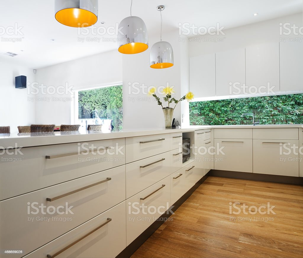 Cabinetry drawers in a new contemporary white kitchen renovation stock photo