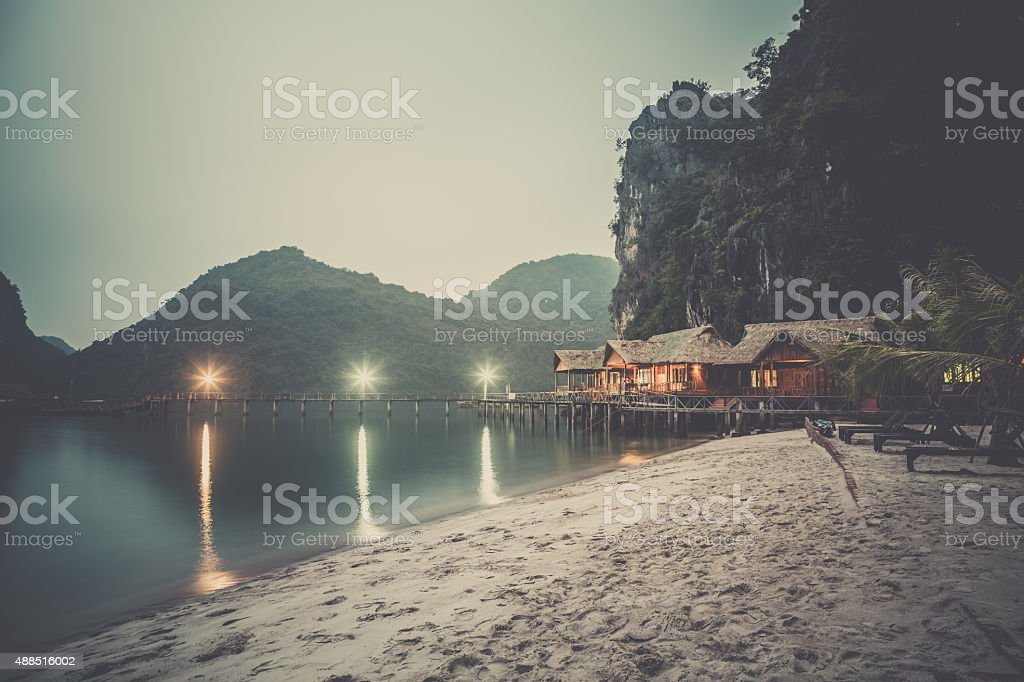 Cabins on Island in Halong Bay at Dusk, Vietnam stock photo