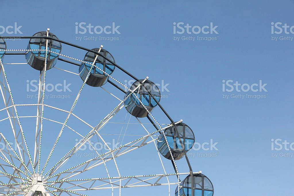 Cabins the ferris wheel against the blue sky stock photo