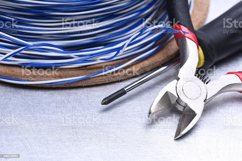 Cable and tools for electrical and telecommunication installation stock photo