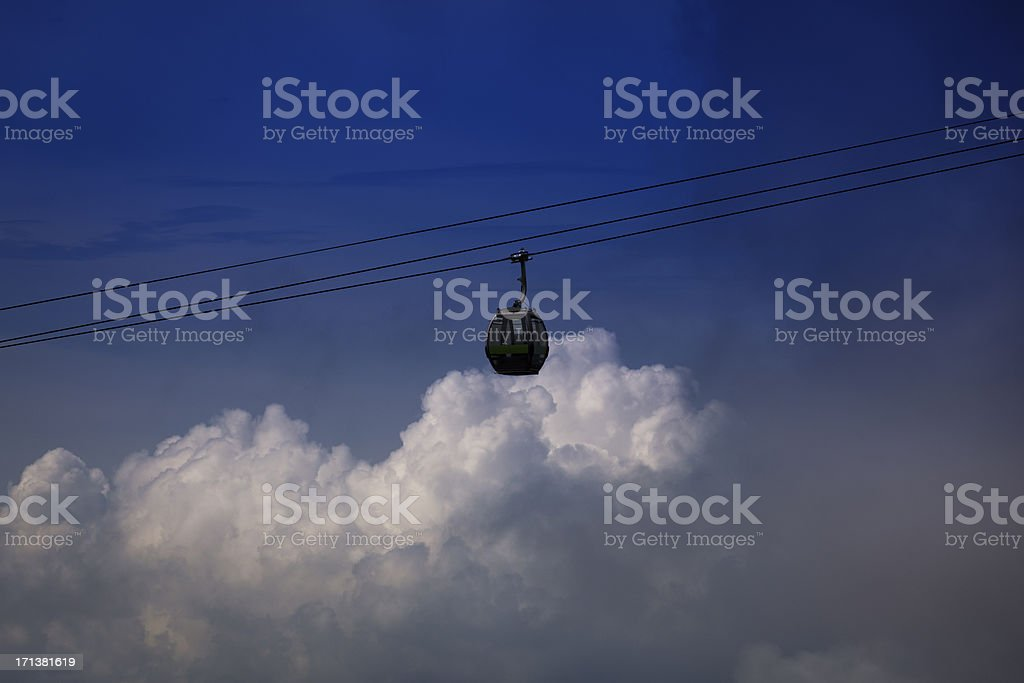 cable car above the clouds stock photo