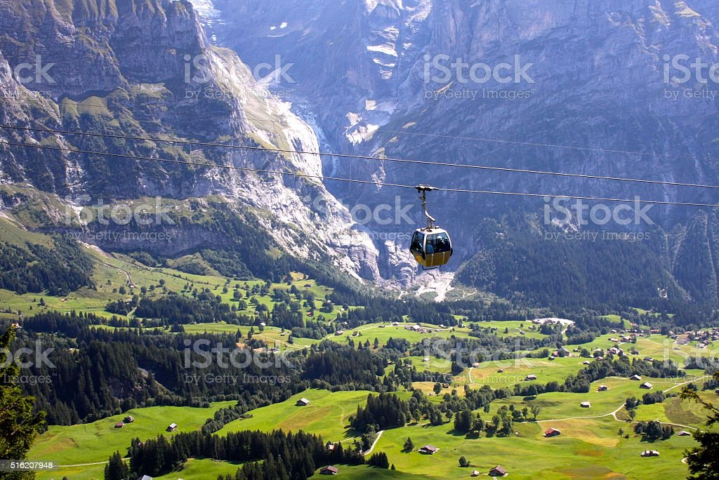 Cable car against scenic view at Grindelwald, Switzerland stock photo
