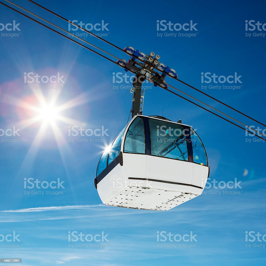 Cable car and sun stock photo