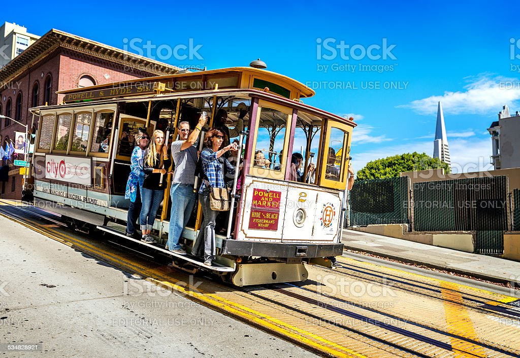 Cable car and Transamerica building in San Francisco stock photo