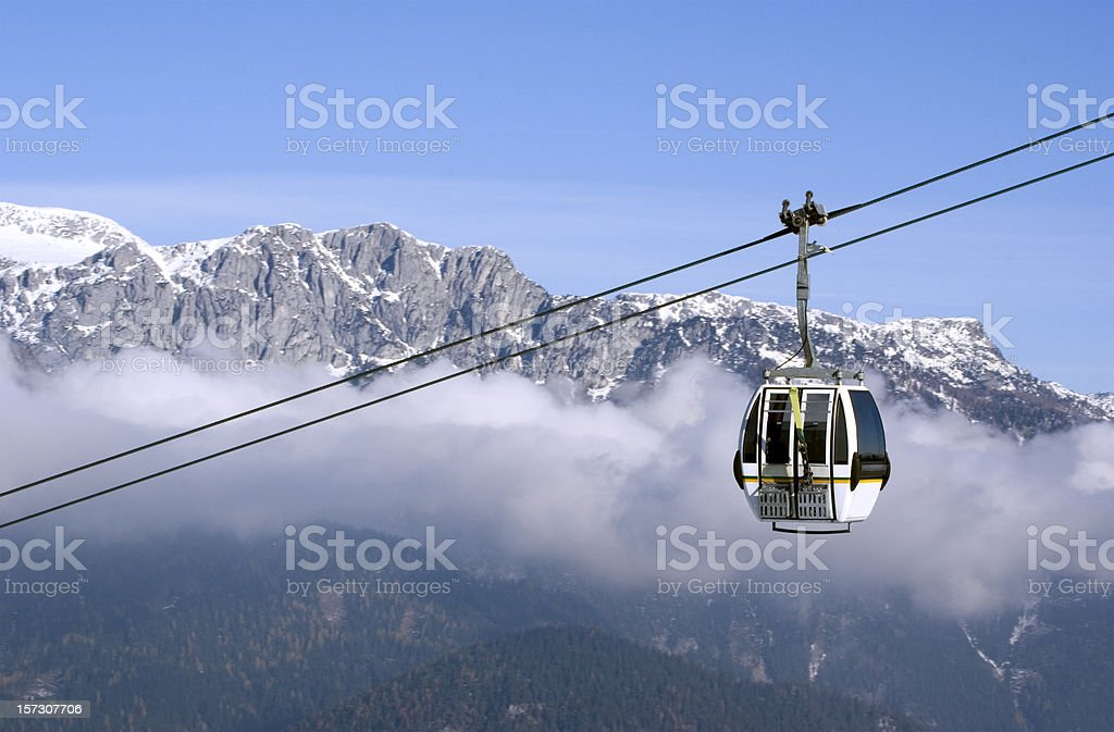 Cable Car Ascending in the Alps stock photo