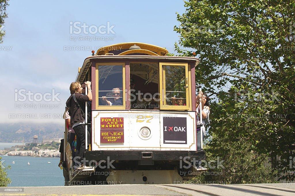 Cable Car Ascends Nob Hill San Francisco with Alcatraz stock photo