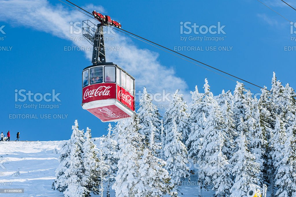 Cable car cabin transports tourists stock photo