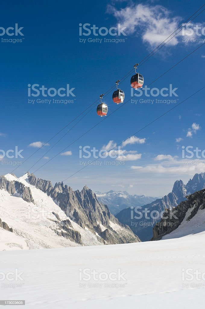 Cable car high above snow stock photo
