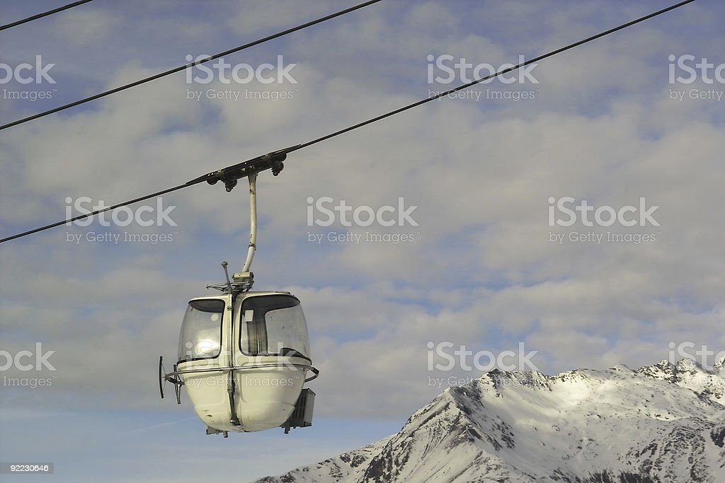 cable car in Alps with mountains and sky royalty-free stock photo