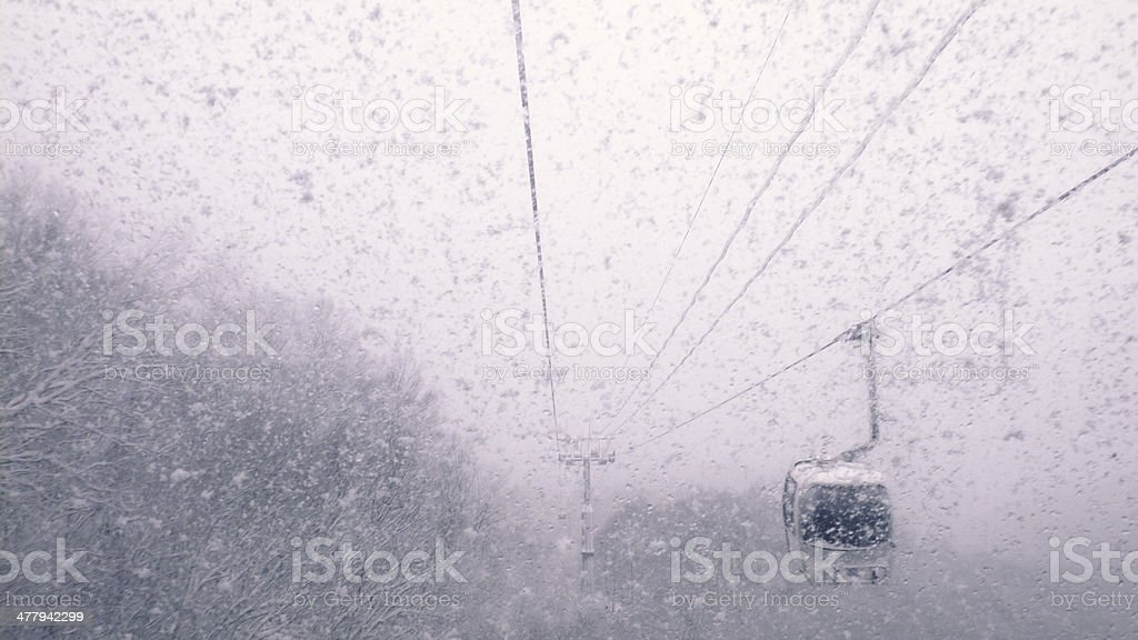 cable car in snowfall royalty-free stock photo