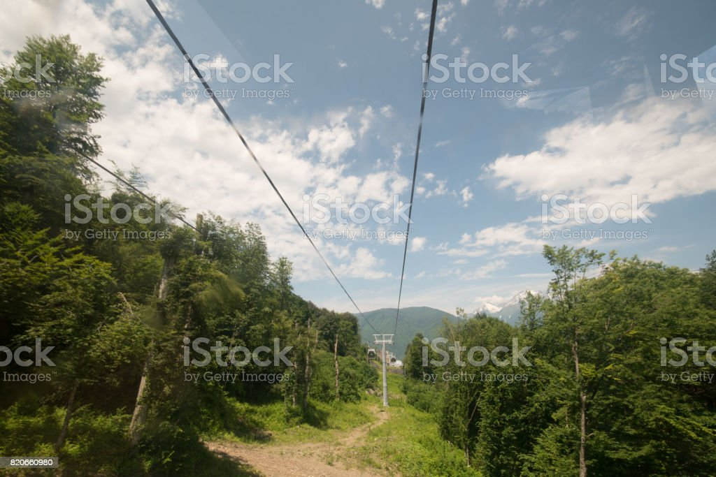 Cable car in the mountains stock photo