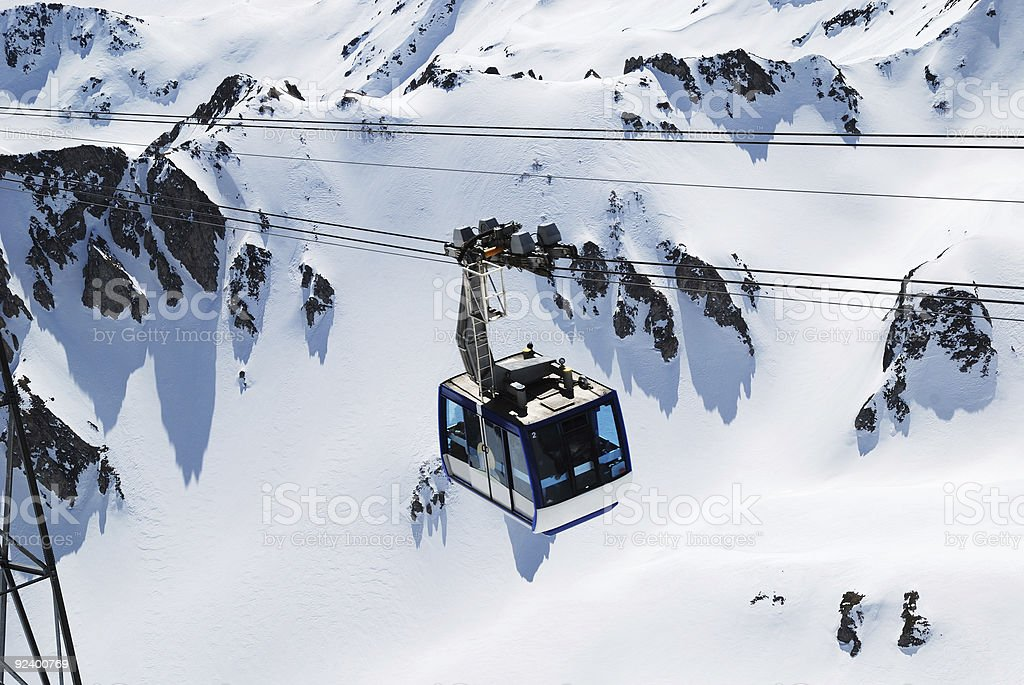 Cable car of pendant road against winter mountainside royalty-free stock photo