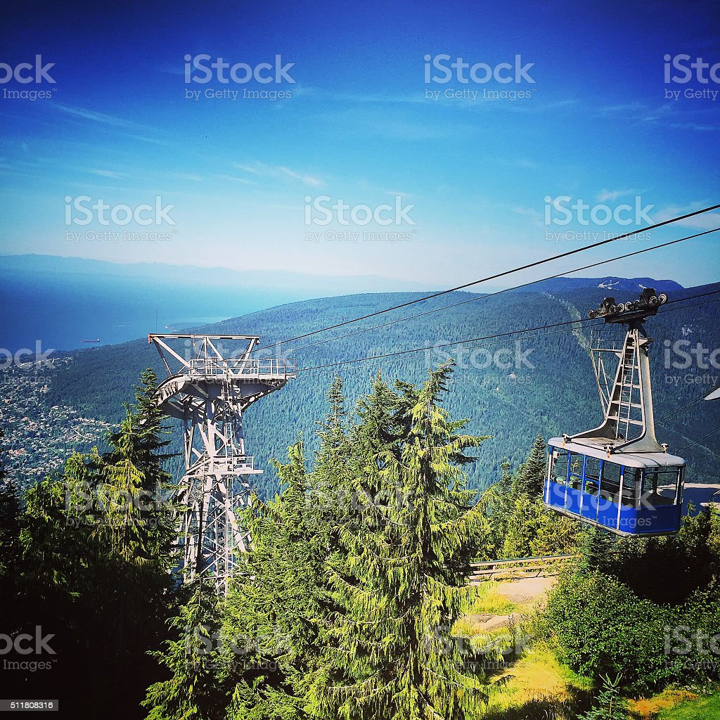 Cable car on the mountain side. stock photo