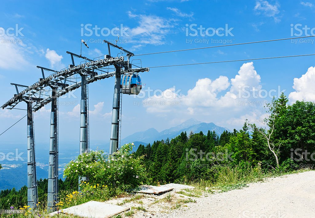 Cable car over alpine forest. Empty mountain bike elevator. stock photo