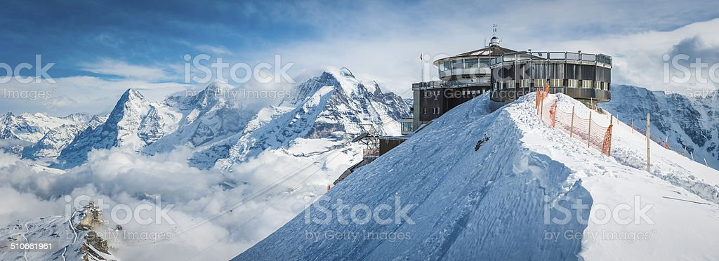 Cable car station on snowy mountain idyllic winter peak panorama stock photo