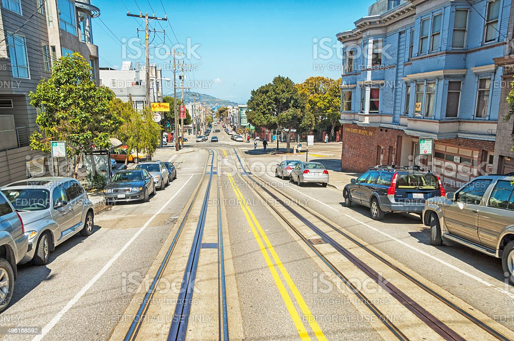 Cable Car Tracks Street View with Pedestrian and Bay View stock photo
