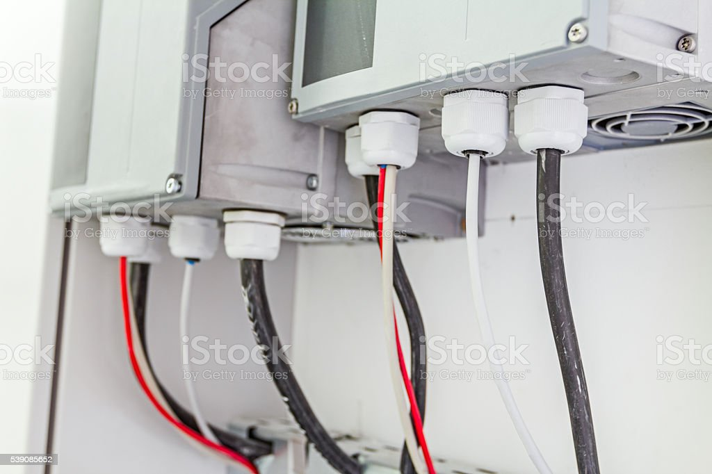 Cable glands on power connections at electricity distribution. stock photo