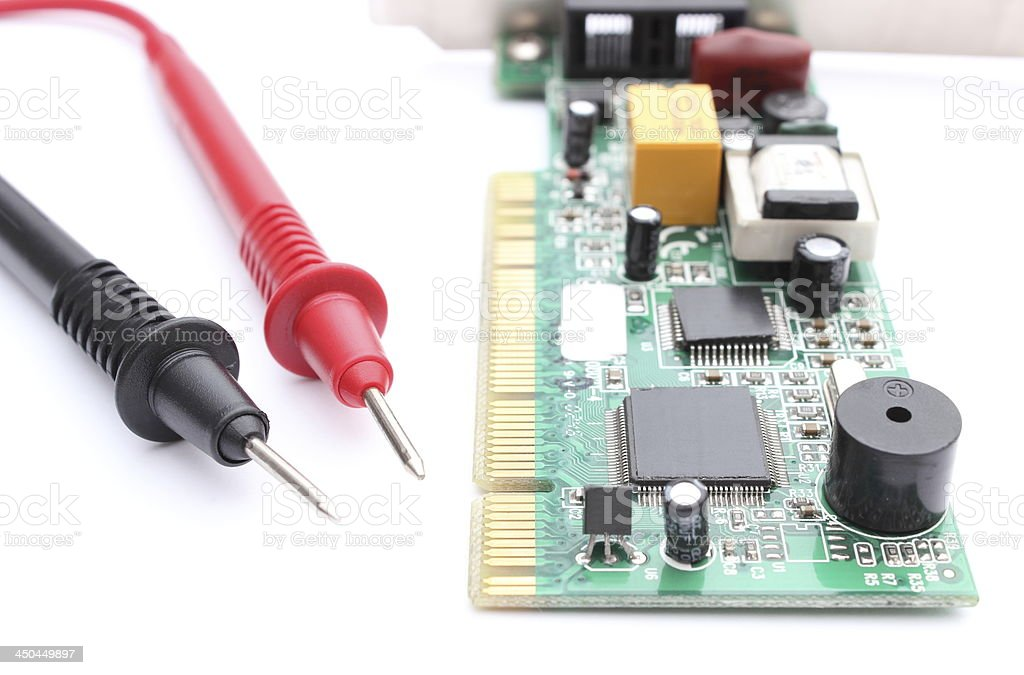 Cable multimeter with circuit board isolated on white background royalty-free stock photo