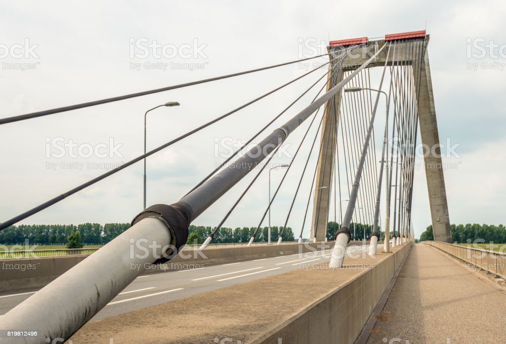 Cable of a Dutch cable-stayed bridge from close stock photo