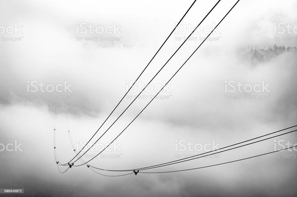 cable railway in the mountains in a cloudy day stock photo