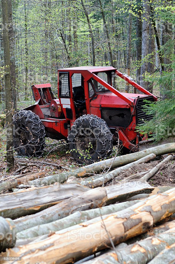 Cable skidder and logs stock photo