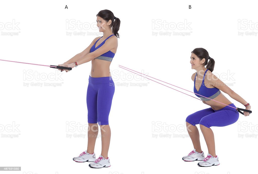 Cable squat to row stock photo
