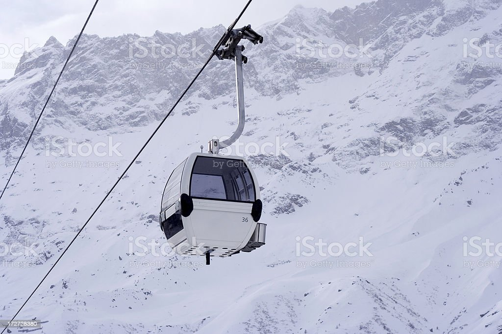 Cable way in snowing time royalty-free stock photo