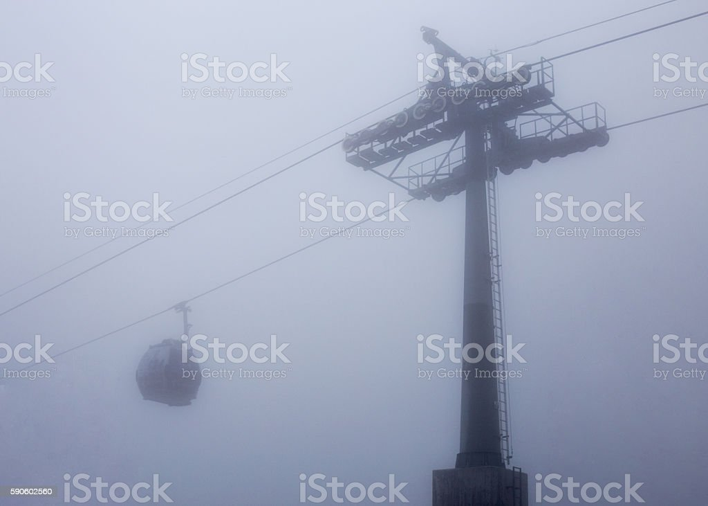 cable way with one cabin car in deep mist white stock photo