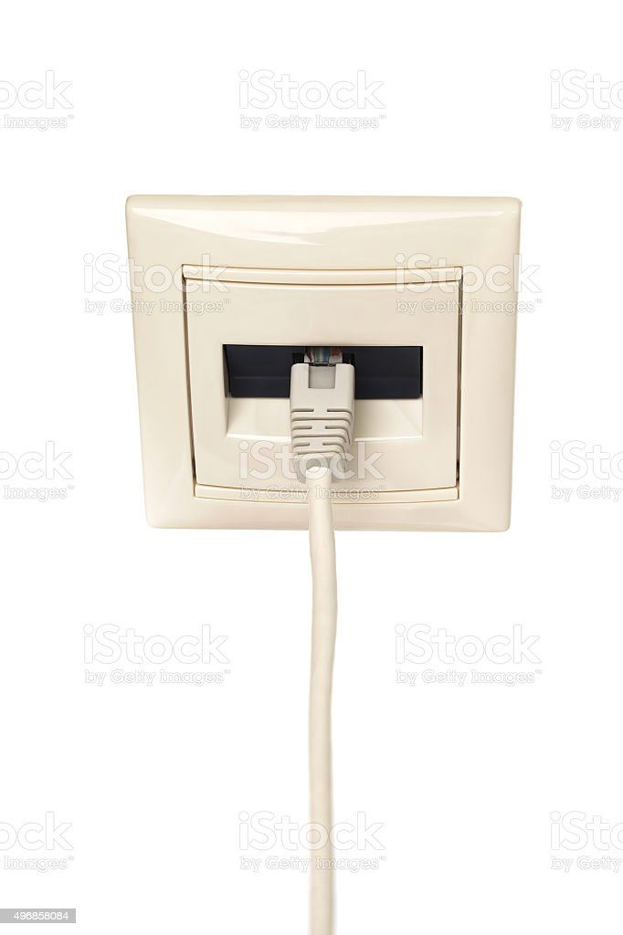Cable with RJ-45 connector is connected to a wall outlet stock photo