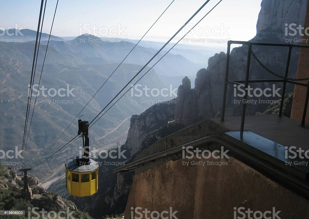 Cablecar Descending from Misty Mountains stock photo