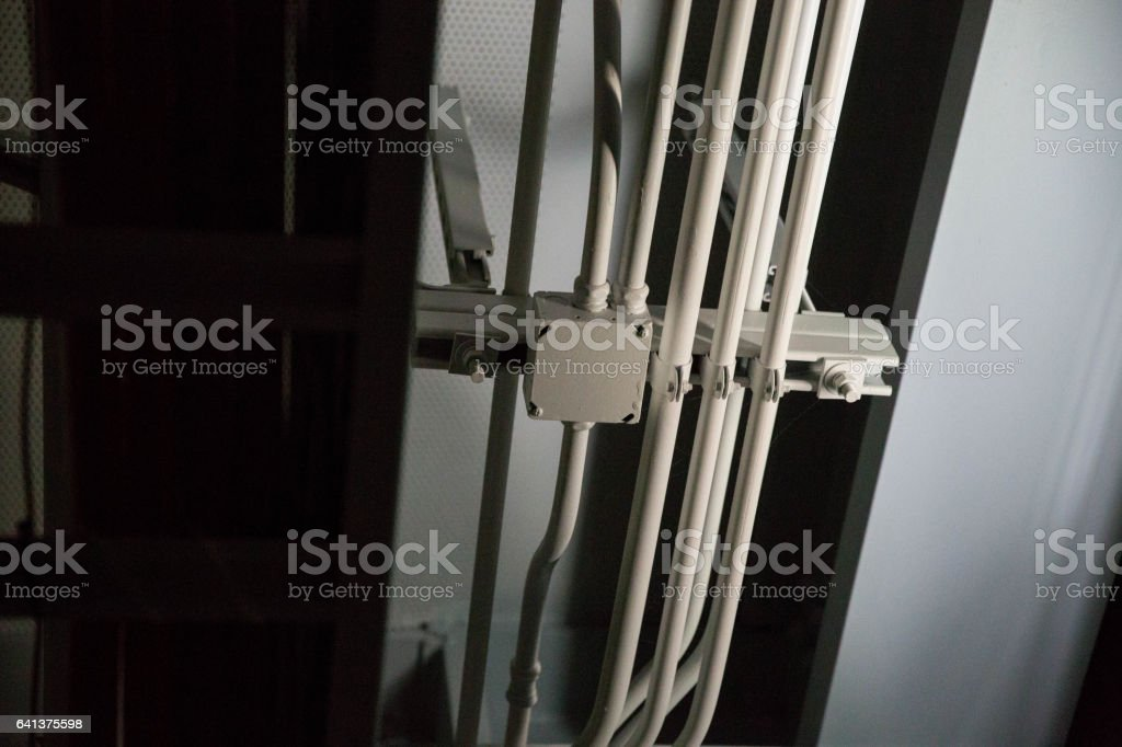 Cables and Pipes Running on Ceiling stock photo