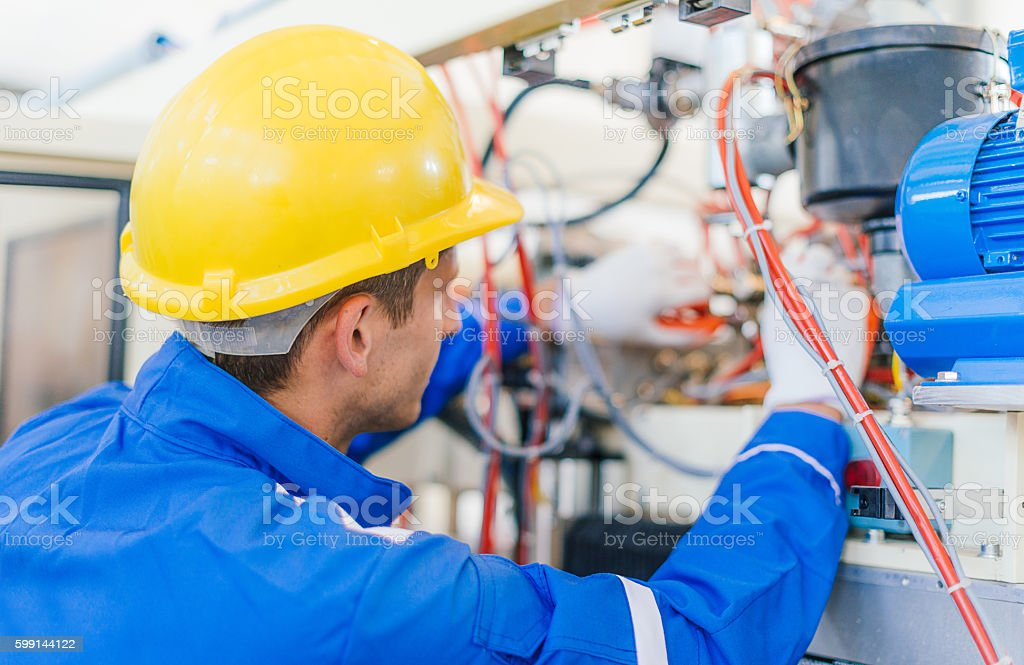 Cables and wires in new machine in factory stock photo