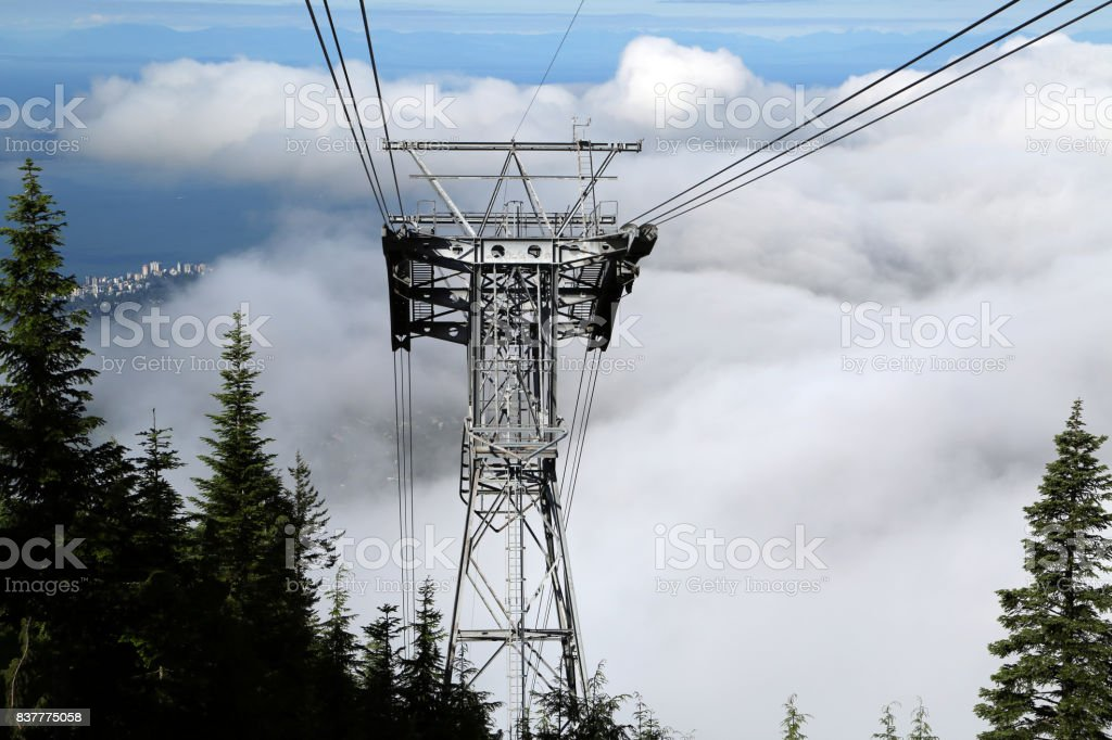 Cables running through clouds stock photo