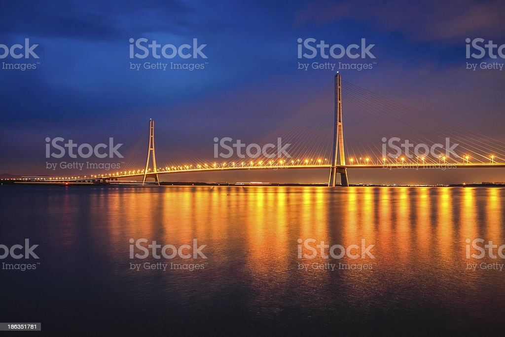 cable-stayed bridge at night royalty-free stock photo