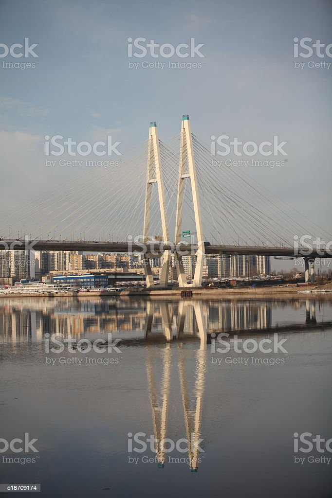 cable-stayed bridge reflected in the river stock photo
