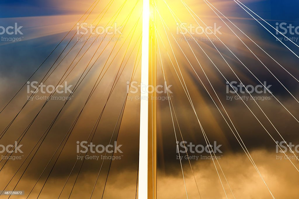 Cable-stayed bridge with sun stock photo