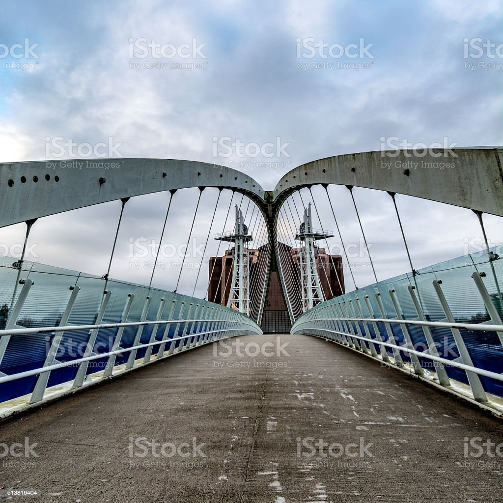 Cable-Stayed Suspension Bridge With Moody Dramatic Sky. stock photo