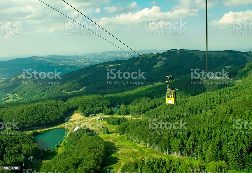 cableway cabin in the mountains stock photo