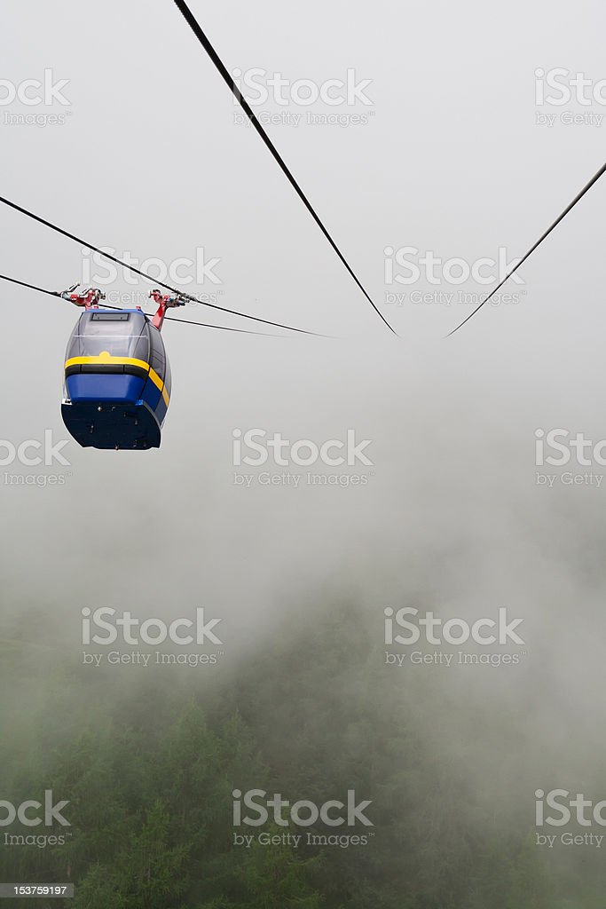 Cableway in fog stock photo