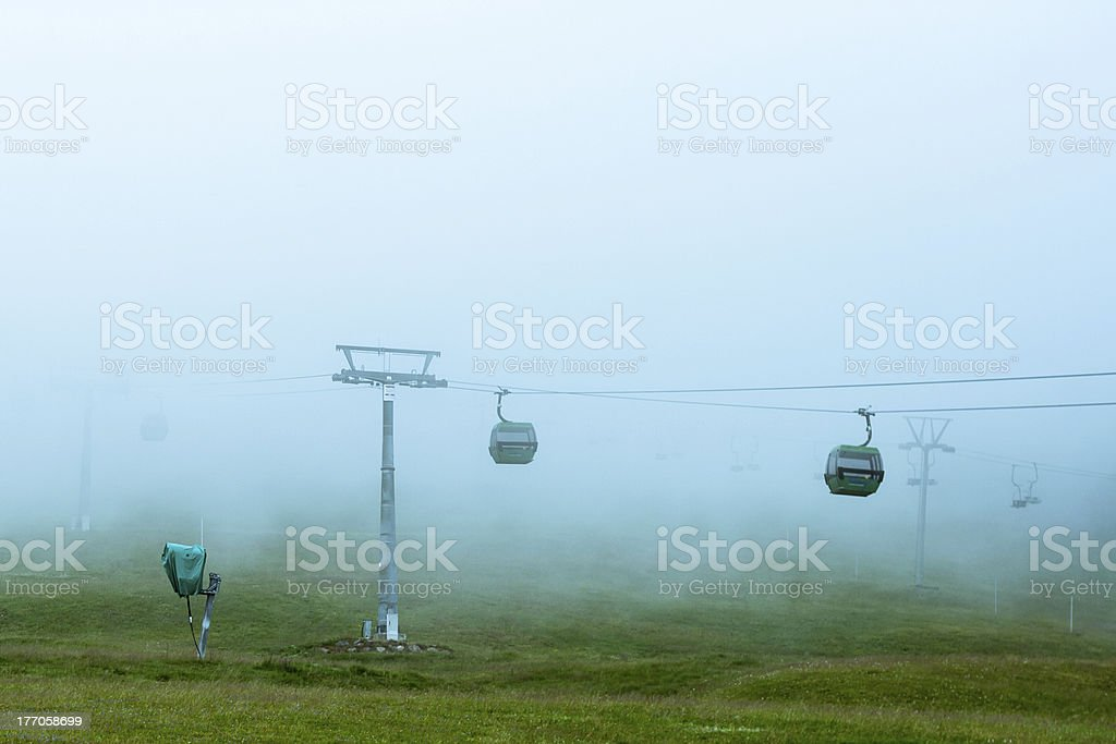 Cableway in the fog  black forest Germany Feldberg royalty-free stock photo