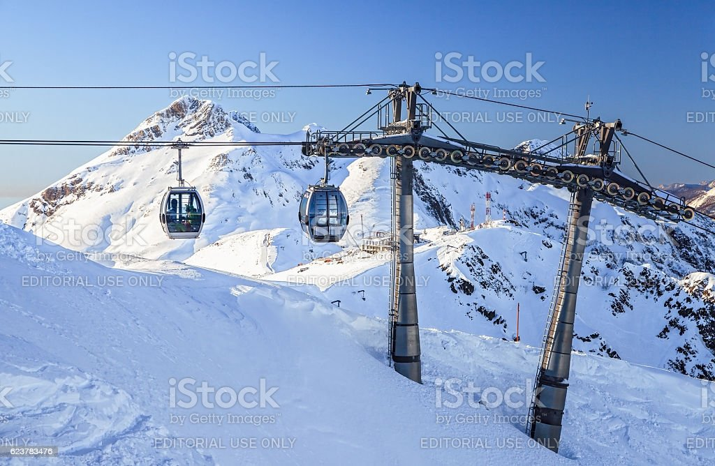 Cableway lifts on snowy mountains background beautiful winter scenic landscape stock photo