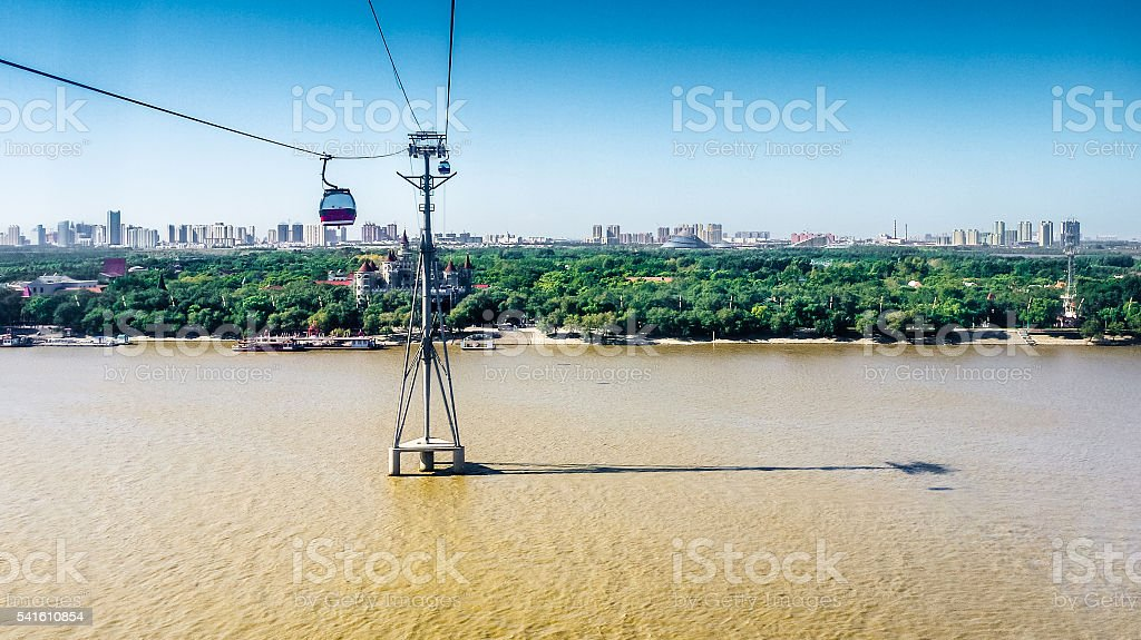 cableway over Songhua River towards south of Sun Island, Harbin stock photo