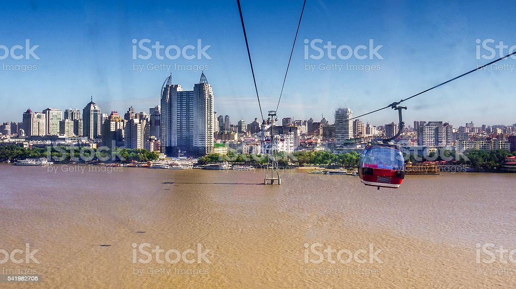 cableway over Songhua River towards southern bank urban skyline, Harbin stock photo