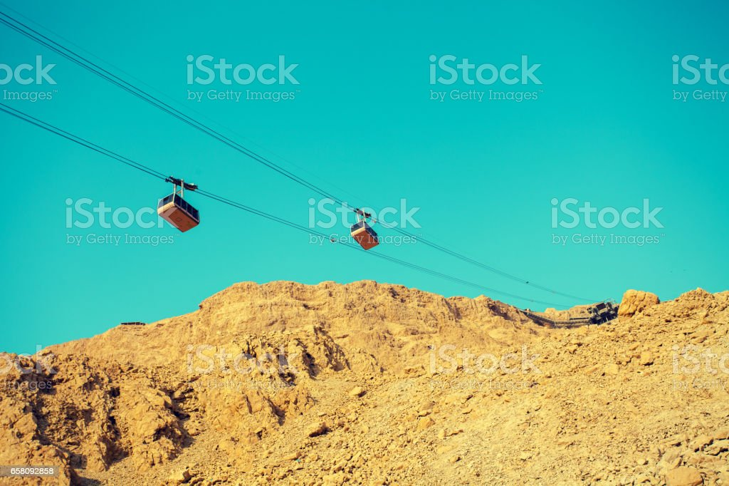 Cableway to Masada fortress, Israel. Sanrise over Judaean desert stock photo