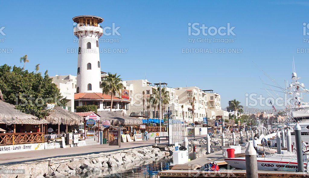 Cabo San Lucas Marina and boardwalk with tourist establishments stock photo